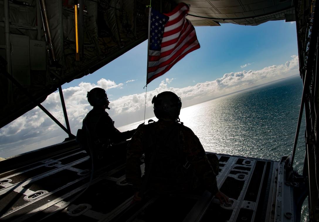 A photo of Airmen watching the ocean.