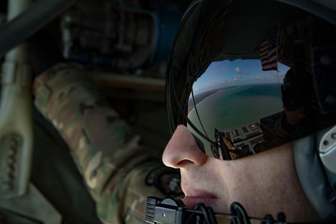 A photo of an Airman watching the ocean.