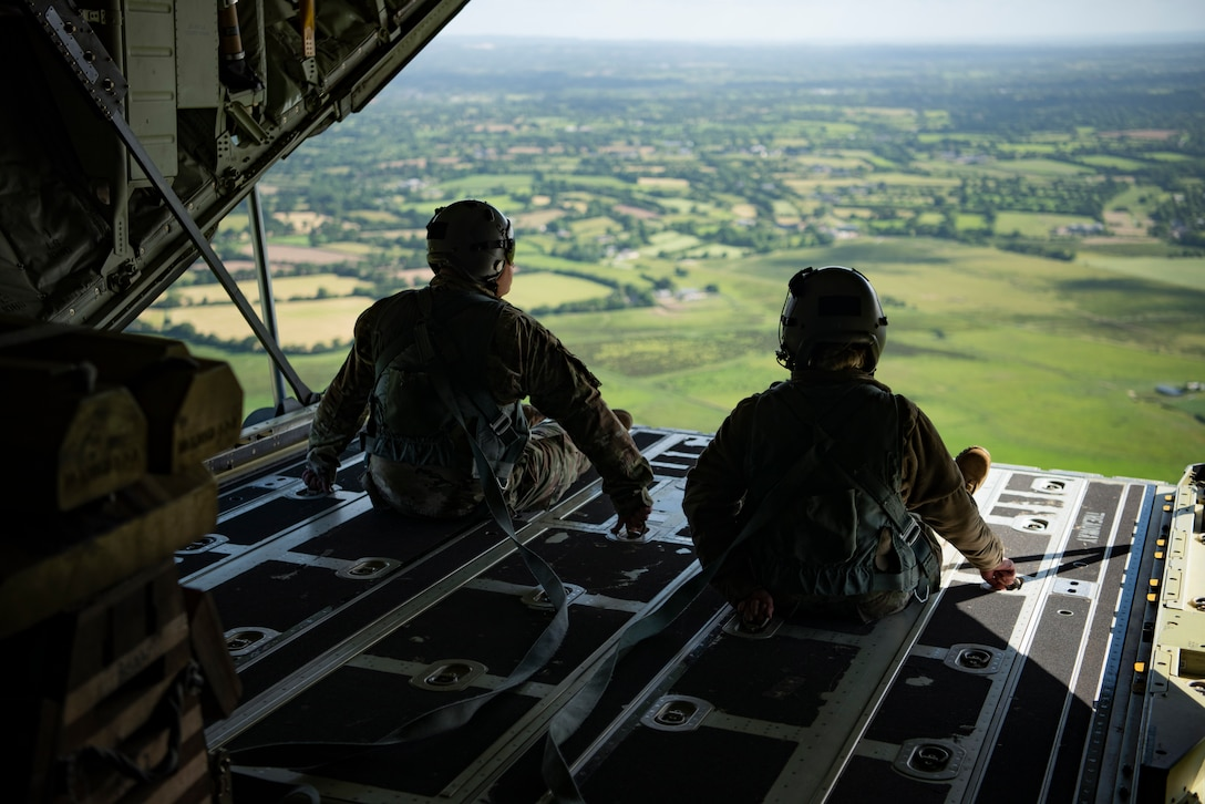 A photo of Airmen looking at the countryside