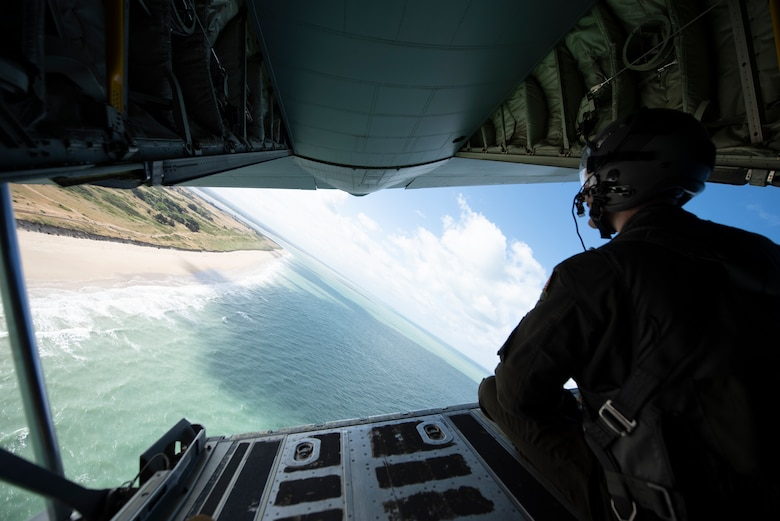 A photo of an Airman looking at the ocean.
