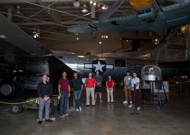 """U.S. Marines with 6th Marine Corps Distrct pose for a group photo next to the """"City of Savannah"""" Boeing B-17 Flying Fortress on display at the Mighty Eighth Air Force Museum in Pooler, Georgia on June 5, 2020. Marines with 6th MCD spent a day enhancing their knowledge on military tactics, operations and history from the displays at the Mighty Eighth Air Force Museum. (U.S. Marine Corps photo by Cpl. Jack A. E. Rigsby)"""