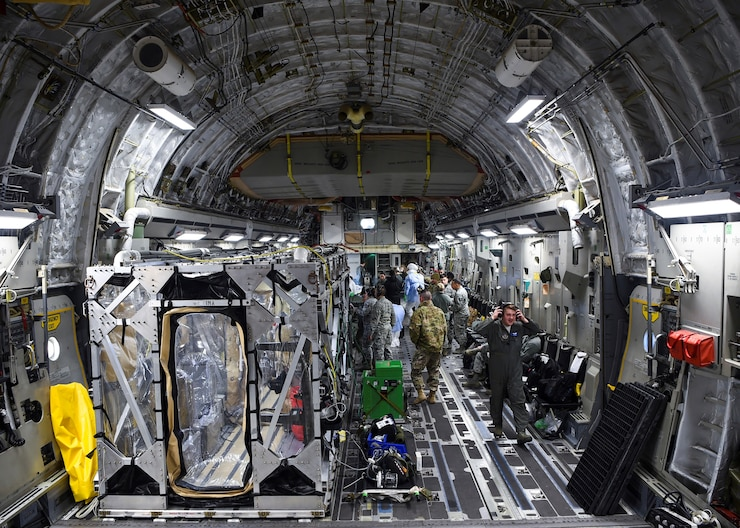 A U.S. Air Force C-17 Globemaster III is prepped to transport a transportation isolation system March 6, 2019, during a training exercise that allows Airmen to practice the most effective and safest form of transportation for patients and their medical professionals.