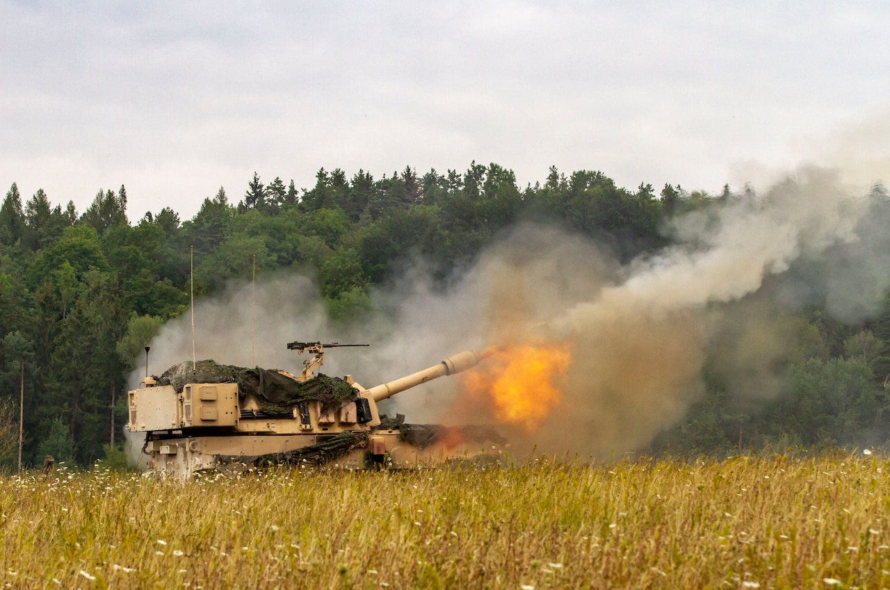 A self-propelled howitzer fires.