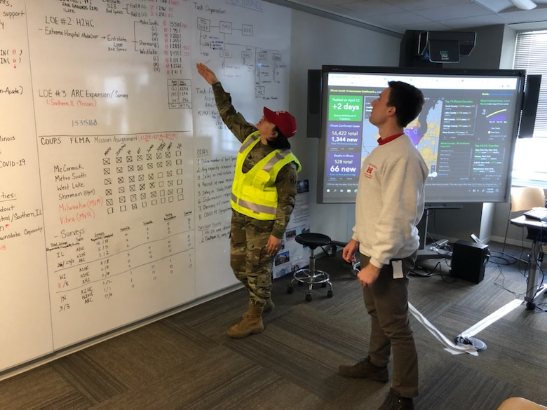 Capt. Carolyn N. Ortiz-Merced discusses the U.S. Army Corps of Engineers Chicago District's COVID-19 projects while serving as the battle captain in the district's Emergency Operations Center during the fight against COVID-19.