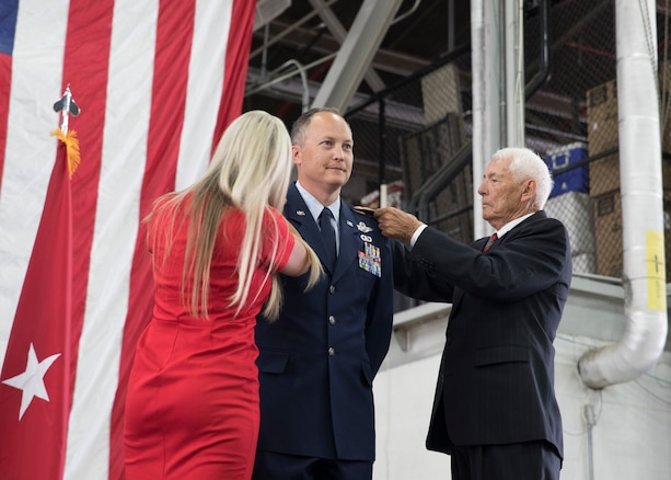 Col. Daniel Boyack, commander Utah Air National Guard, is pinned on by his wife, Michelle and father, Lt. Col (ret) Paul Boyack, as he promotes to the rank of Brigadier General