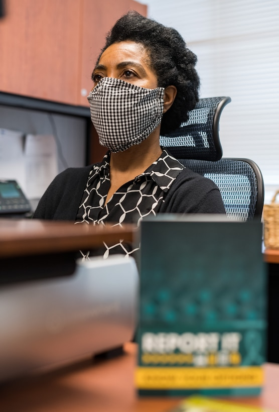 Gail Reed-Attoh, 436th Airlift Wing Sexual Assault Response Coordinator, works at her desk, May 29, 2020, at Dover Air Force Base, Delaware. Reed-Attoh and two alternate SARCs are available 24/7 to support sexual assault victims. (U.S. Air Force photo by Roland Balik)