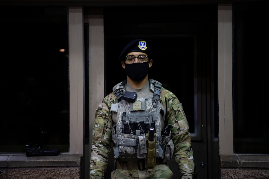 A Defender from the 432nd Security Forces Squadron poses for a photo during their nightshift at Creech Air Force Base