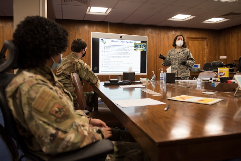U.S. Air Force Master Sgt. Miriam Pantoja, 501st CSW Judge Advocate Office, NCOIC of general law, conducts a deployment brief June 2, 2020, at RAF Alconbury, England. The 501st Combat Support Wing legal office hosted a deployment brief and will execution ceremony for all Security Forces deploying in the next 60 days. (U.S. Air Force photo by Airman 1st Class Jennifer Zima)