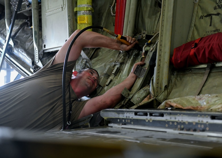 Tech. Sgt. Jason Felts, 19th Maintenance Squadron sheet metal production lead, drills a hole in a new 3D printed hydraulic pump bracket at Little Rock Air Force Base, Arkansas, June 4, 2020. The re-creation of the part acted as an opportunity to completely revamp the structure and strength of the part to decrease the amount of repairs that are needed over time. (U.S. Air Force photo by Airman 1st Class Jayden Ford)