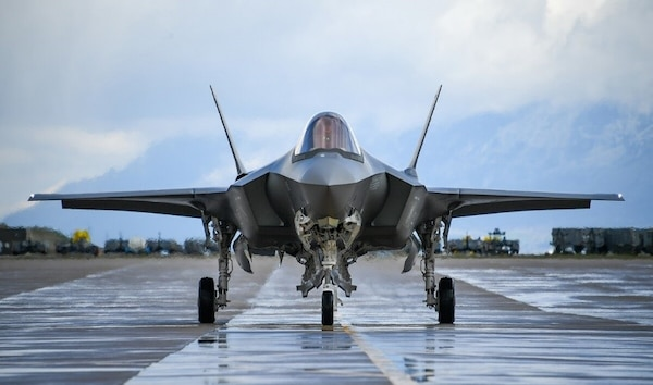 an f-35 aircraft taxis for takeoff