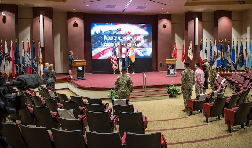 As part of Army tradition, the audience sings the Army song at the conclusion of the U.S. Army Security Assistance Command's relinquishment of command ceremony, 2 June 2020, at Redstone Arsenal, AL.