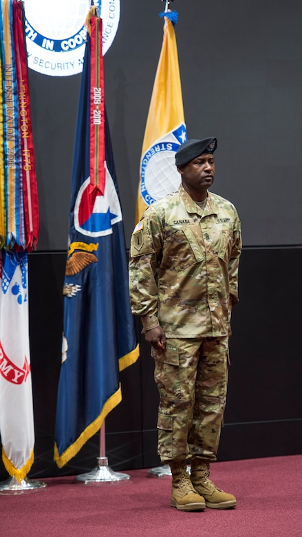 Command Sgt. Maj. Gene Canada, U.S. Army Security Assistance Command's command sergeant major, stands at attention prior to the official passing of the colors, during a relinquishment of command ceremony, 2 June 2020, at Redstone Arsenal.
