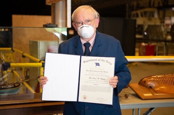 Dana Wegner, the Curator of Navy Ship Models at Naval Surface Warfare Center Carderock Division, receives the Department of the Navy Distinguished Civilian Service Award on June 4, 2020.