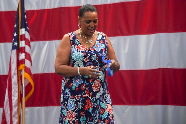Janice Jones, 2nd Bomb Wing chief of protocol, preps tape to be used as a placeholder during practice of the 96th Bomb Squadron change of command ceremony at Barksdale Air Force Base, La., May 28, 2020. The protocol mission involves keeping leadership informed of where they're needed for official and social events. (U.S. Air Force photo by Senior Airman Taylor Hunter)