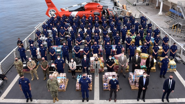 he Coast Guard Cutter James crew and interagency partners stand amongst 30,000 pounds of interdicted narcotics.