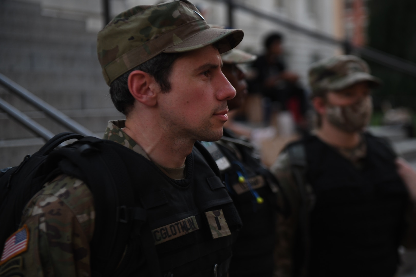 District of Columbia National Guard 1st Lt. John McGlothlin, an Army attorney, patrols Gallery Place Chinatown June 6, 2020, in Washington, D.C. McGlothlin was activated to help keep peace so demonstrators could protest.