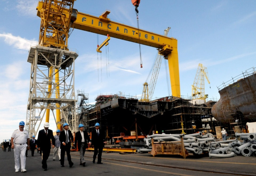 US officials tour the Fincantieri Shipyard in Genoa, Italy, the largest shipyard in Europe.