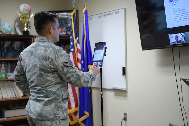 U.S. Air Force Tech. Sgt. Fransisco Jimenez, 17th Force Support Squadron Airman Leadership School instructor, uses Zoom for Government to talk with class 20-E in the Consolidated Learning Center, Goodfellow Air Force Base, Texas, June 4, 2020. The students of 20-E were the first class to be taught via Zoom at Goodfellow, to maintain safety guidelines put in place due to COVID-19. (U.S. Air Force photo by Senior Airman Zachary Chapman)