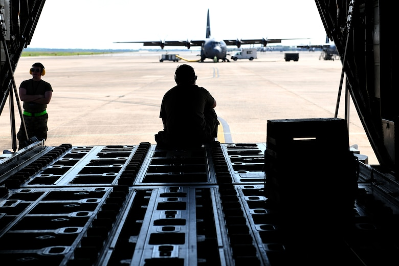 Maintainers wait to send-off a C-130J Super Hercules for a Joint Forcible Entry exercise at Little Rock Air Force Base, Arkansas, June 6, 2020. Each C-130J within the JFE exercise simulated dropping approximately 70 paratroopers while in the formation. (U.S. Air Force photo by Senior Airman Kristine M. Gruwell)