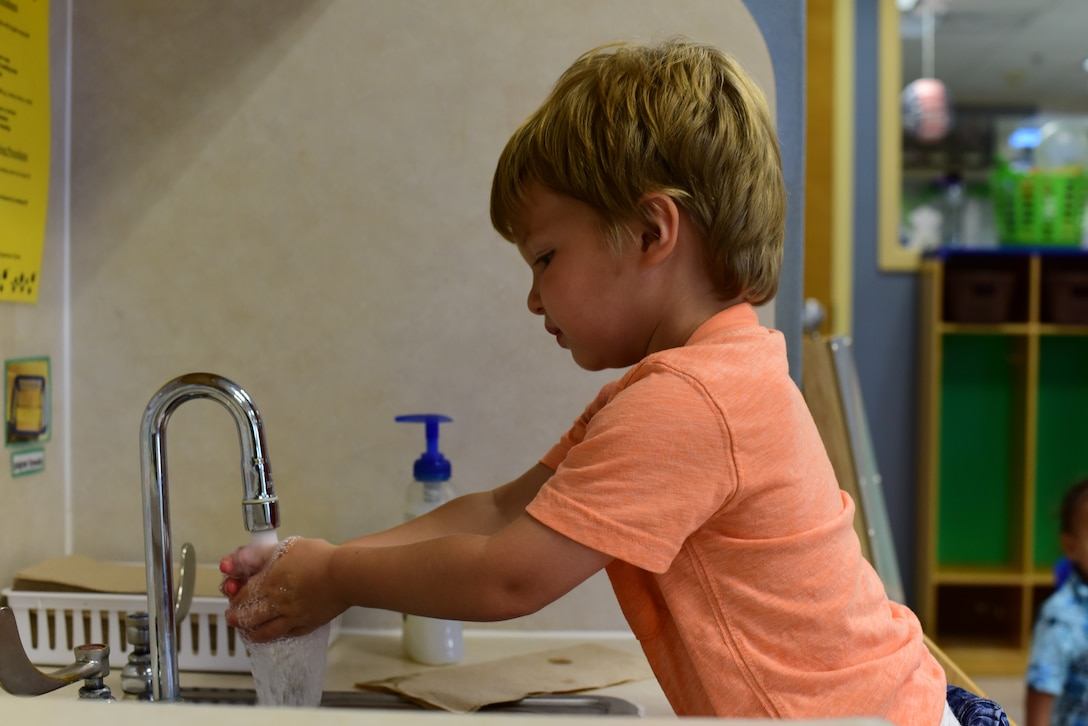 A child from the Child Development Center at Laughlin Air Force Base, Texas, washes his hands between activities, June 5, 2020. Even before the outbreak of COVID-19, the caretakers led the children in washing of hands before meals, between activities and such. (U.S. Air Force Photo by Senior Airman Anne McCready)