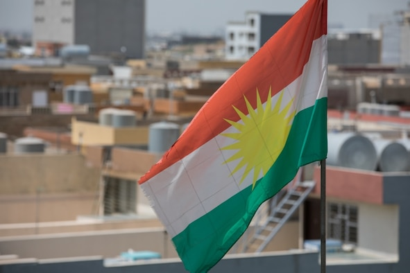 The Kurdistan flag waves atop a government building of the Iraqi autonomous region of Kurdistan during an engagement between Coalition Forces and members of the Peshmerga media cell in Erbil, Iraq, 2 May 2019. The engagement was to discuss media capabilities and offer assistance to strengthen them.
