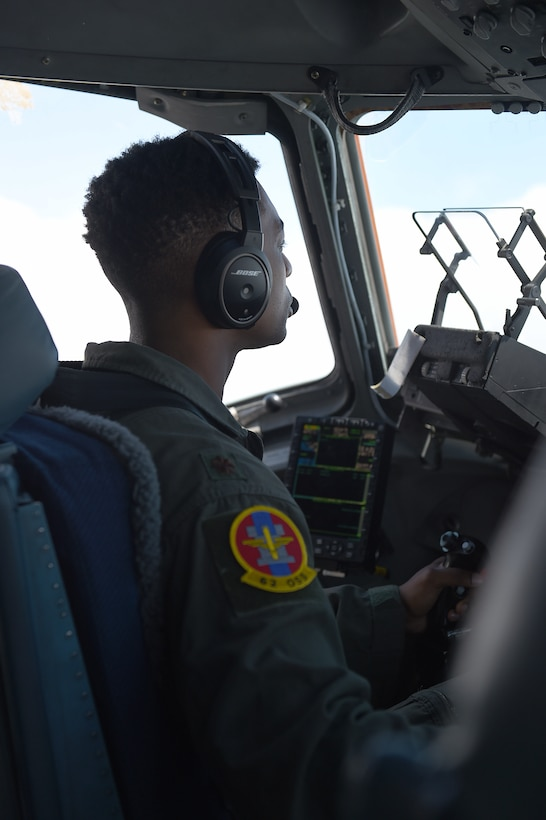 U.S. Air Force Maj. James Hall, 62nd Operations Support Squadron operations officer and pilot, flies a C-17 Globemaster III during a joint force exercise over the Nevada test and training range, June 6, 2020. During this flight Hall tested an updated dynamic re-tasking capability (DRC) system that enabled increased situational awareness of the simulated battle space during the exercise.  (U.S. Air Force photo by Airman 1st Class Mikayla Heineck)