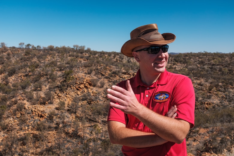 Tech. Sgt. Andrew Bryan, 709th Technical Maintenance Squadron, Detachment 421 noncommissioned officer in charge of maintenance, supervises three Airmen in charge of maintaining a seismic array in the outback of Alice Springs, Australia, Aug. 28, 2019. Data from the array is used to detect seismic activity, to include nuclear detonations or earthquakes. (U.S. Air Force photo by Master Sgt. Benjamin Wilson)