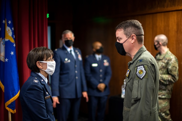 U.S. Air Force Col. Suzie Dietz, 60th Aeromedical Evacuation Squadron commander, speaks with Col. Jeffrey Nelson, 60th Air Mobility Wing commander, following an assumption of command ceremony June 9, 2020, at Travis Air Force Base, California. Dietz was formerly the 99th Inpatient Operations Squadron commander at Nellis AFB, Nevada. (U.S. Air Force photo by Senior Airman Christian Conrad)