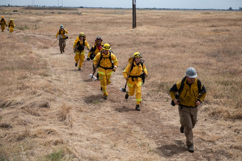 9th Civil Engineer Squadron firefighters run in response to a call of a wildfire on Beale Air Force Base.