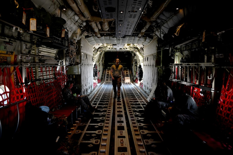 A loadmaster assigned to the 61st Airlift Squadron prepares a C-130J Super Hercules for flight at Little Rock Air Force Base, Arkansas, June 6, 2020. More than 20 C-130Js and C-17 Globemaster IIIs flew in formation during the U.S. Air Force Weapons School's Joint Forcible Entry exercise with numerous other aircraft from across the Air Force. (U.S. Air Force photo by Senior Airman Kristine M. Gruwell)