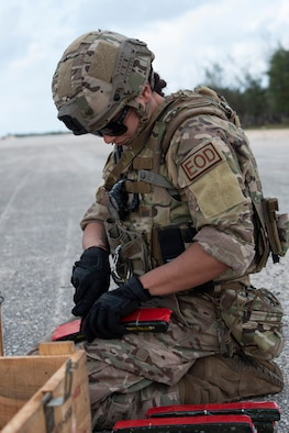 An Explosive Ordnance Disposal technician with the 36th Civil Engineer Squadron prepares her equipment during a Rapid Airfield Damage Repair (RADR) Exercise at Andersen Air Force Base, Feb. 12, 2020. The RADR Training was conducted as a part of Cope North 2020, an annual U.S. Pacific Air Forces joint/combined, trilateral field training exercise. (U.S. Air Force photo by Airman 1st Class Amir R. Young)