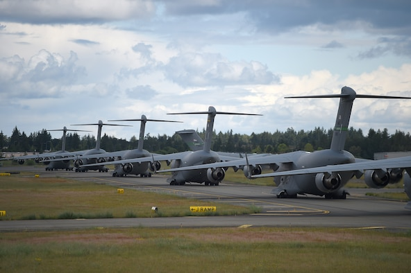A formation of C-17 Globemaster IIIs from the 62nd Airlift Wing, 446th Airlift Wing, and Joint Base Elmendorf-Richardson, Alaska, prepare to take off from Joint Base Lewis-McChord, Wash., June 6, 2020. These aircraft made up a small portion of the 87 total that participated in a weapons instructor course joint force training exercise over the Nevada Test and Training Range. (U.S. Air Force photo by Airman 1st Class Mikayla Heineck)