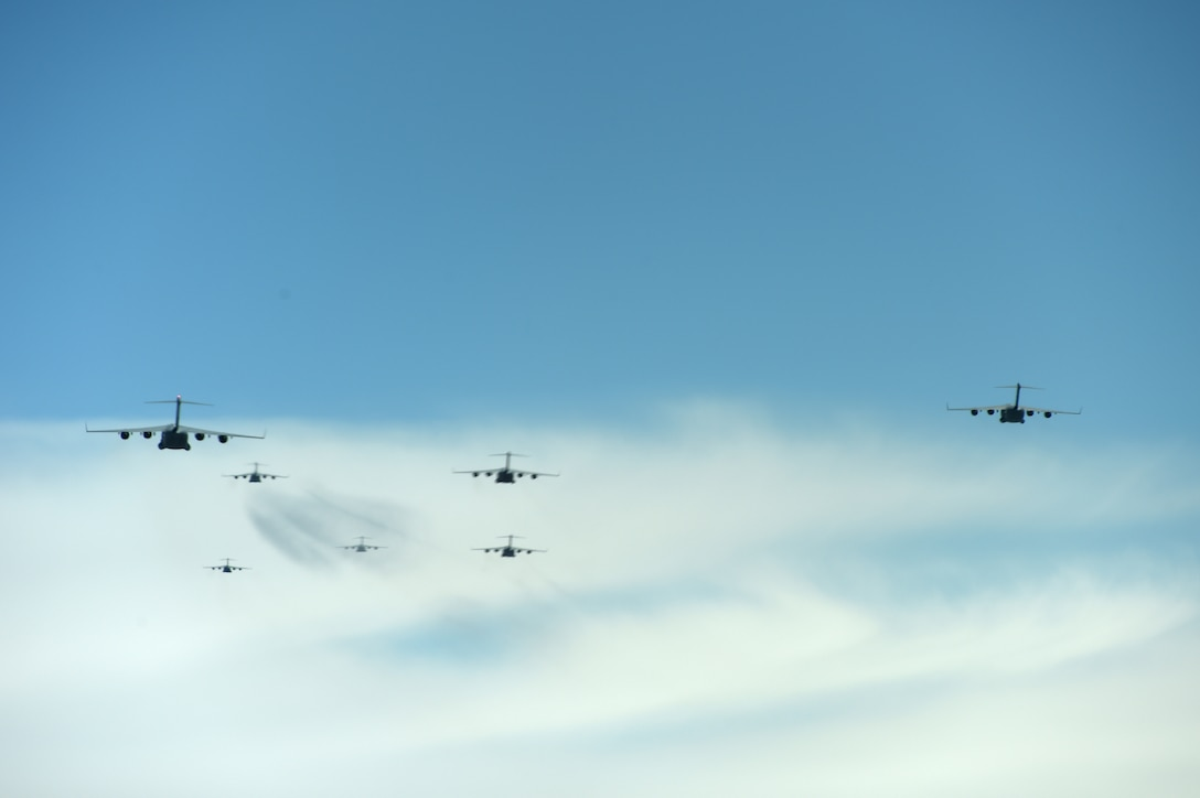 A formation of C-17 Globemaster III aircrafts from the 62nd Airlift Wing, 446th Airlift Wing, and Joint Base Elmendorf-Richardson, fly in a joint force exercise over the Nevada test and training range, June 6, 2020. The C-17's made up a section of the 87 total aircraft that participated in this exercise which was the capstone event for a weapons instructor course class. (U.S. Air Force photo by Airman 1st Class Mikayla Heineck)
