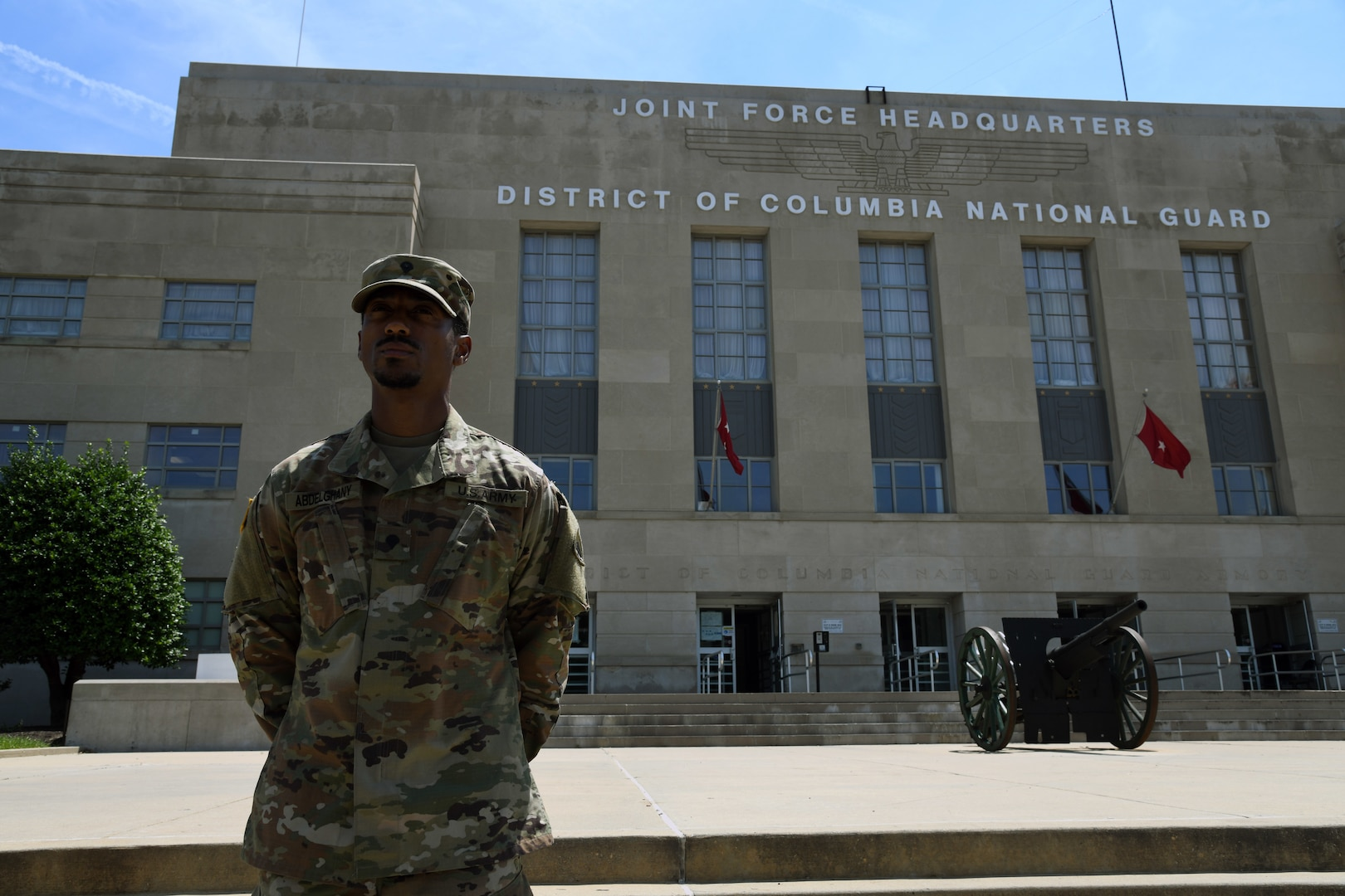 Spc. Khaled Abdelghany, 273rd Military Police Company, District of Columbia National Guard, stands in front of the D.C. Armory in Washington, D.C June 9, 2020.