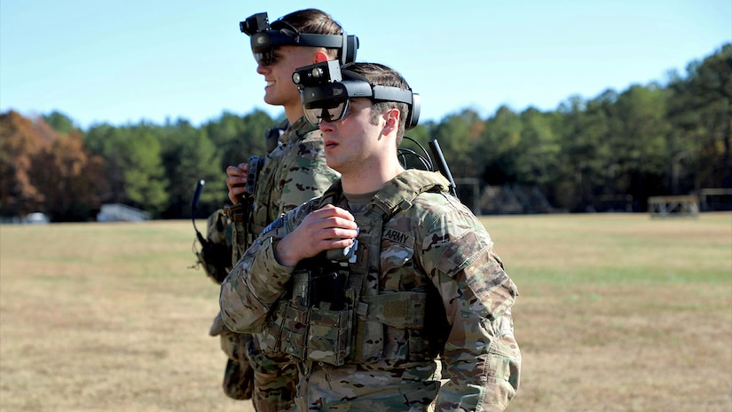 Soldiers don the Integrated Visual Augmentation System (IVAS) Capability Set 2 (CS 2) Heads Up Display (HUD) at Soldier Touchpoint 2 (STP 2) in November 2019 at Fort Pickett, Va.