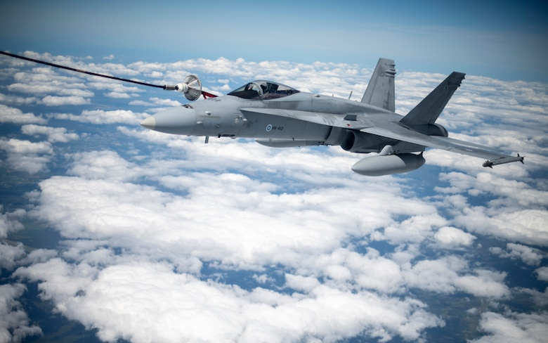 A Finnish air force F/A-18 Hornet is refueled by a U.S. Air Force KC-135 Stratotanker assigned to the 100th Air Refueling Wing, RAF Mildenhall, England, during Exercise Baltic Operations, over Poland, June 9, 2020. BALTOPS brings together a robust professional constellation of allies and partners to conduct operations that safeguard security, prosperity and the free and open international order. (U.S. Air Force photo by Tech. Sgt. Emerson Nuñez)