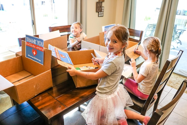 children prepare a package of treats