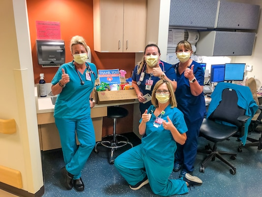 Nurses with a care package