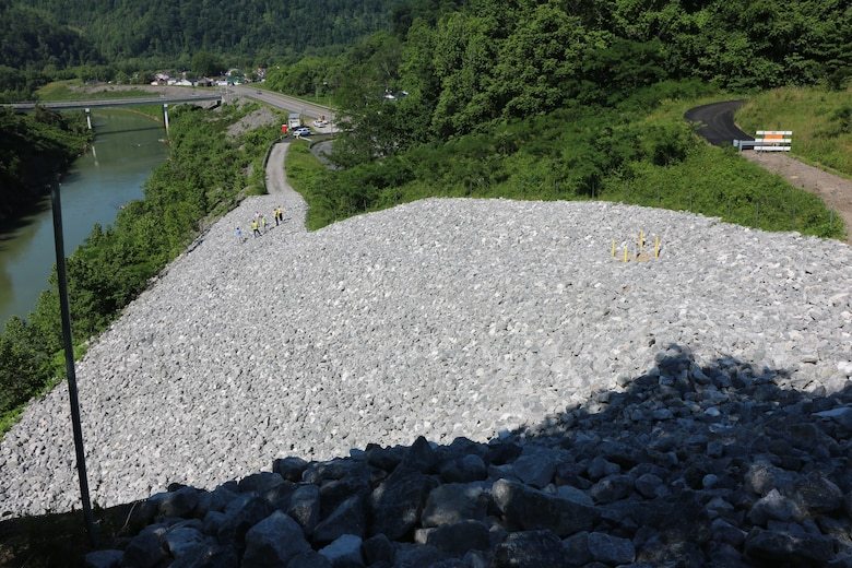 U.S. Army Corps of Engineers Nashville District officials check the completed repair of a slope above the Cumberland River diversion channel in Loyall, Kentucky during a site visit June 3, 2020. (USACE photo)