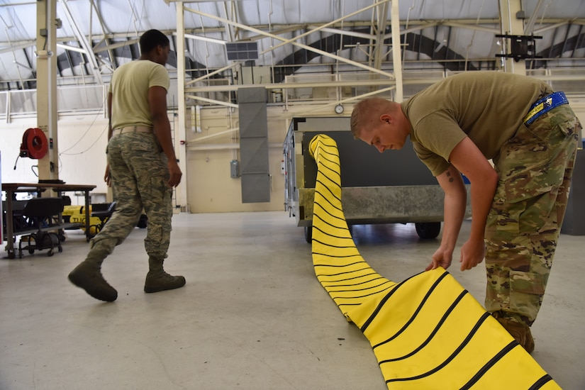 Senior Airman Spencer Cook, 437th Maintenance Squadron Aerospace Ground Equipment technician, inspects the cooling air duct on a TLD manufactured air conditioner at joint base Charleston S.C., June 3, 2020. Members of the 437th MXS accept, fix and maintain equipment used on aircraft and in back shops to do maintenance inspections in order to keep the flight line a more lethal and ready force.