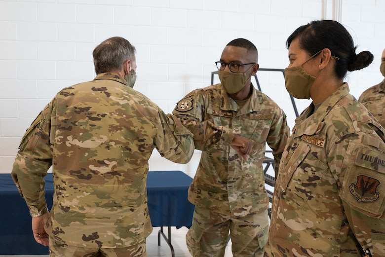 Gen. David L. Goldfein, Chief of Staff of the Air Force, congratulates Senior Airman Ervin Mooney, 752nd Operations Support Squadron, for achieving Senior Airman Below-the-Zone June 8 at Tinker Air Force Base. Mooney was also recognized for training 15 Airmen in a new Tactical Air Operations Module weapons system. (U.S. Air Force photo by 2nd. Lt. Danny Rangel)