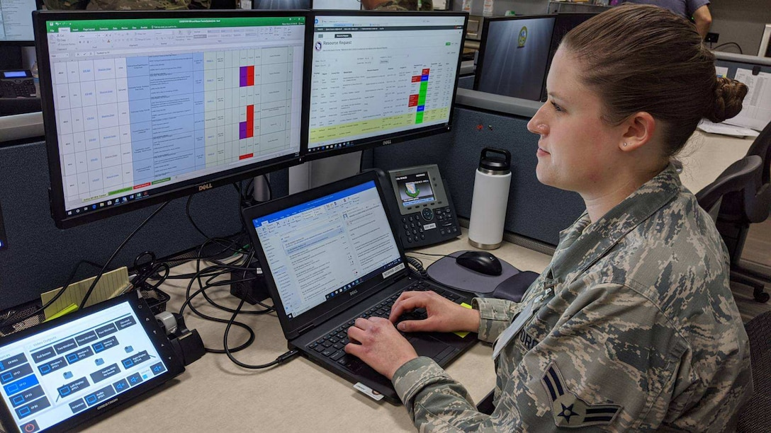 Airman 1st Class Alyssa Meyers, 115th Fighter Wing emergency manager, works at her desk in the Joint Operations Center at the Wisconsin National Guard headquarters in Madison, Wis., June 4, 2020.