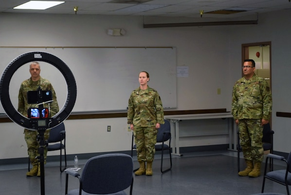 Col. Wayne M. Williams, 433rd Mission Support Group commander, Maj. Kristen B. Fowler, 74th Aerial Port Squadron commander, and Lt. Col. Brian A. Angell, 433rd Logistics Readiness Squadron commander, participate in a change of command ceremony June 6, 2020 at Joint Base San Antonio-Lackland, Texas.