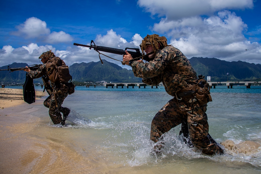 U.S. Marines with Lima Company, 3rd Battalion, 3d Marine Regiment, traverse through water during an amphibious assault exercise, Marine Corps Base Hawaii, May 28, 2020. Bravo Company, 1st Battalion, 3d Marine Regiment, and Lima Company, 3rd Battalion, 3d Marine Regiment, conducted an amphibious assault exercise and military operations in urban terrain to increase littoral mobility proficiency in 3d Marine Regiment and advance the goals of the Commandant of the Marine Corps 2030 Force Design.