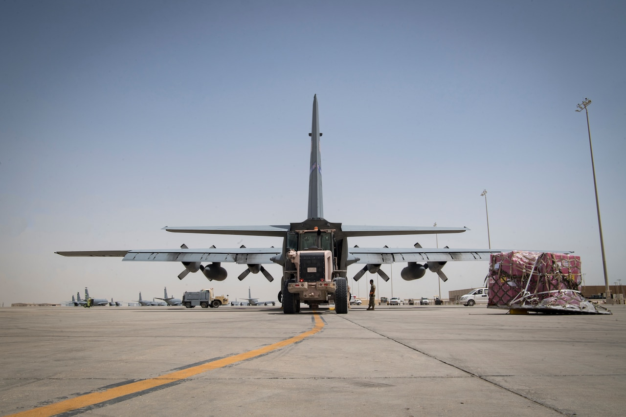 Cargo is loaded onto an air transport plane.