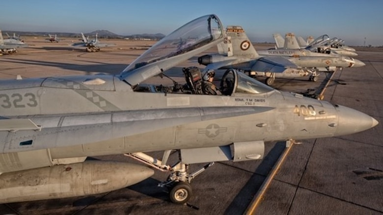"""Capt. Meleah Martin, a pilot with Marine Fighter Attack Squadron (VMFA) 323, prepares an F/A-18C Hornet for flight at Marine Corps Air Station Miramar, Calif. Marines like Martin keep 3rd Marine Aircraft Wing ready to """"Fix, Fly and Fight"""" as the Corps' largest aircraft wing. 3rd MAW continues to answer the call of this nation whenever and wherever it is needed."""