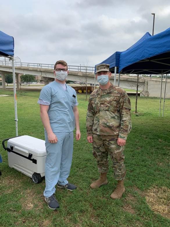 Lab assistants from Wilford Hall Medical Center at Lackland Air Force Base, Texas, assist with receiving specimens at Lackland's flight line, May 20, 2020. The specimens were collected from deployers at Cannon Air Force Base, New Mexico, to test for COVID-19. (Courtesy Photo)