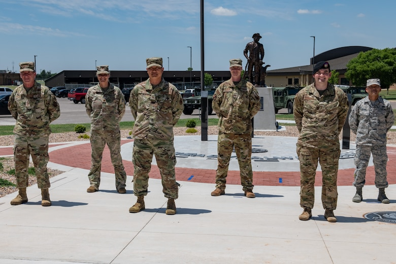 Air Force Chief of Staff Gen. David L. Goldfein poses alongside Airmen from around Will Rogers Air National Guard Base (WRANGB) after a coining ceremony in front of the Minuteman Memorial on base June 8, 2020, in Oklahoma City. The Airmen were nominated to receive a coin based on outstanding conduct and performance in their Guard careers.