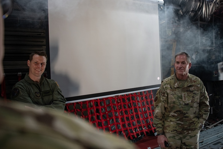 Air Force Chief of Staff Gen. David L. Goldfein stands in a haze of smoke as he listens alongside Maj. Morgan, training and innovation special projects officer for the 137th Special Operations Group, to a presentation on the base's C-130 Hercules fuselage trainer by Maj. Jefferey Carlson, senior flight nurse examiner for the 137th Aeromedical Evacuation Squadron, during a base tour on June 8, 2020, at Will Rogers Air National Guard Base in Oklahoma City. The fuselage trainer is fully certified by the Air Mobility Command and can simulate any scenario that would happen on the aircraft in flight, including fire and smoke and a high-fidelity sound system to simulate rapid decompression.