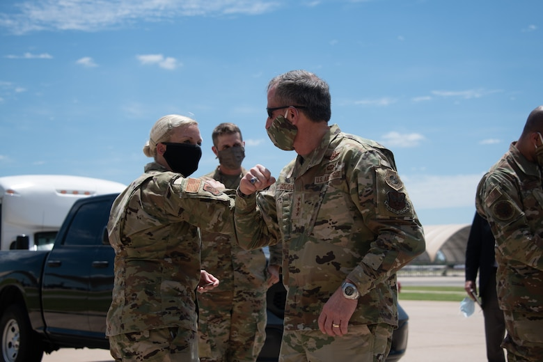 Air Force Chief of Staff Gen. David L. Goldfein bumps elbows with Capt. Audrey Mitchell, operations officer for the 137th Special Operations Logistics Readiness Squadron, during a base tour on June 8, 2020, at Will Rogers Air National Guard Base in Oklahoma City. The work of the 137th Special Operations Wing in support of intelligence, surveillance and reconnaissance missions has come across Goldfein's desk in recent months; and, in light of his upcoming visit, allowed the Wing to highlight its outstanding Airmen and highlight some of the most prominent features of the base that help execute the mission of the MC-12W.